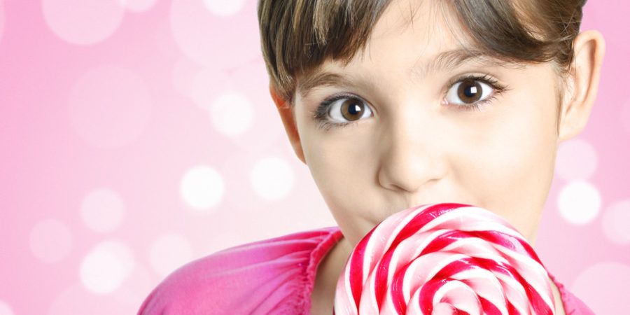 Global Confectionery girl with pink lollipop